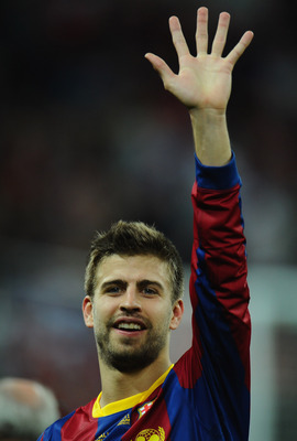 LONDON, ENGLAND - MAY 28:  Gerard Pique of FC Barcelona waves after victory during the UEFA Champions League final between FC Barcelona and Manchester United FC at Wembley Stadium on May 28, 2011 in London, England.  (Photo by Clive Mason/Getty Images)