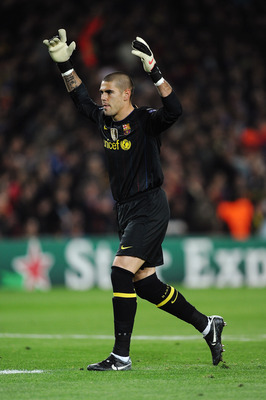 BARCELONA, SPAIN - APRIL 06:  Goalkeeper Víctor Valdés of Barcelona celebrates during the UEFA Champions League quarter final second leg match between Barcelona and Arsenal at Camp Nou on April 6, 2010 in Barcelona, Spain.  (Photo by Jasper Juinen/Getty I
