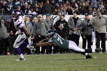 PHILADELPHIA, PA - DECEMBER 28: Joe Webb #14 of the Minnesota Vikings breaks a tackle Juqua Parker #75 of the Philadelphia Eagles to score a touchdown in the 3rd quarter at Lincoln Financial Field on December 28, 2010 in Philadelphia, Pennsylvania. (Photo