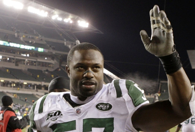 CINCINNATI - JANUARY 9:  Linebacker Bart Scott #57 of the New York Jets walks off the field after defeating the Cincinnati Bengals in the 2010 AFC wild-card playoff game at Paul Brown Stadium on January 9, 2010 in Cincinnati, Ohio. (Photo by Andy Lyons/Ge