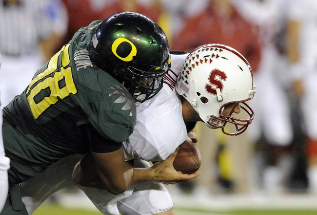 EUGENE, OR - OCTOBER 2: Quarterback Andrew Luck #12 of the Stanford Cardinal is sacked by defensive end Kenny Rowe #58 of the Oregon Ducks in the third quarter of the game at Autzen Stadium on October 2, 2010 in Eugene, Oregon. Oregon won the game 52-31.