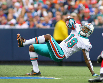ORCHARD PARK, NY - SEPTEMBER 12:  Brandon Marshall #19 of the Miami Dolphins keeps his footing against the Buffalo Bills during the NFL season opener at Ralph Wilson Stadium on September 12, 2010 in Orchard Park, New York.  (Photo by Rick Stewart/Getty Im