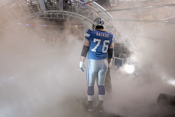DETROIT - SEPTEMBER 24:  Jeff Backcus #76 of the Detroit Lions waits in the smokey tunnel to be introduced before the game against the Green Bay Packers on September 24, 2006 at Ford Field in Detroit, Michigan. The Packers defeated the Lions 31-24. (Photo