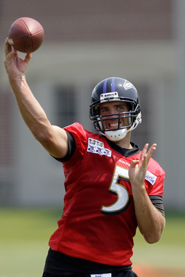 OWINGS MILLS, MD - JULY 29:  Quarterback Joe Flacco #5 of the Baltimore Ravens throws a pass during training camp on July 29, 2011 in Owings Mills, Maryland.  (Photo by Rob Carr/Getty Images)