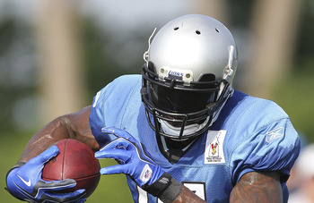 ALLEN PARK, MI - AUGUST 01: Calvin Johnson #81 of the Detroit Lions runs throught the morning drills at the Lions training facility on August 1, 2011 in Allen Park, Michigan.  (Photo by Leon Halip/Getty Images)