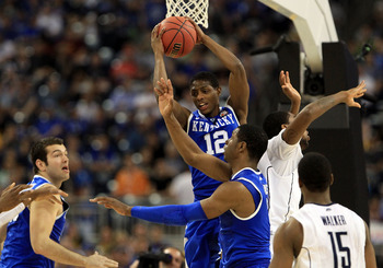 HOUSTON, TX - APRIL 02:  Brandon Knight #12 of the Kentucky Wildcats grabs a rebound against the Connecticut Huskies during the National Semifinal game of the 2011 NCAA Division I Men's Basketball Championship at Reliant Stadium on April 2, 2011 in Housto