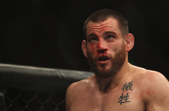 SYDNEY, AUSTRALIA - FEBRUARY 27:  Jon Fitch of the USA looks at the big screen after the first round in his fight against BJ Penn of the USA during their welterweight bout part of  UFC 127 at Acer Arena on February 27, 2011 in Sydney, Australia.  (Photo b