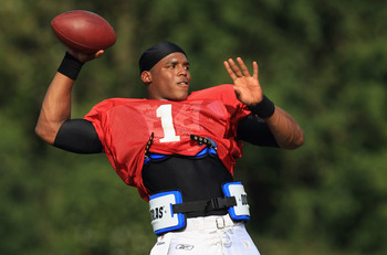 SPARTANBURG, SC - AUGUST 03:  Cam Newton #1 of the Carolina Panthers throws a pass during training camp at Wofford College on August 3, 2011 in Spartanburg, South Carolina.  (Photo by Streeter Lecka/Getty Images)