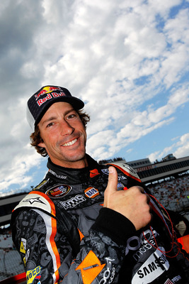 LOUDON, NH - JULY 15:  Travis Pastrana, driver of the #99 Boost Mobile/PWR Toyota, stands on the grid prior to the NASCAR K&N Pro Series East New England 125 at New Hampshire Motor Speedway on July 15, 2011 in Loudon, New Hampshire.  (Photo by Todd Warsha