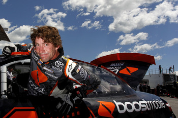 LOUDON, NH - JULY 14:  Travis Pastrana, driver of the #99 Boost Mobile/PWR Toyota, climbs from his car during practice for the NASCAR K&N Pro Series East New England 125 at New Hampshire Motor Speedway on July 14, 2011 in Loudon, New Hampshire.  (Photo by