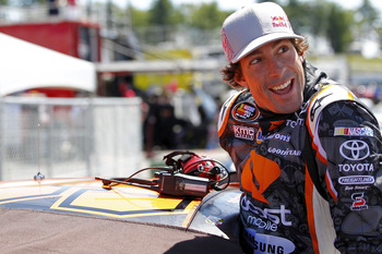 LOUDON, NH - JULY 14:  Travis Pastrana, driver of the #99 Boost Mobile/PWR Toyota, climbs into his car during practice for the NASCAR K&N Pro Series East New England 125 at New Hampshire Motor Speedway on July 14, 2011 in Loudon, New Hampshire.  (Photo by