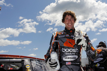 LOUDON, NH - JULY 14:  Travis Pastrana, driver of the #99 Boost Mobile/PWR Toyota, gestures after climbing from his car during practice for the NASCAR K&N Pro Series East New England 125 at New Hampshire Motor Speedway on July 14, 2011 in Loudon, New Hamp