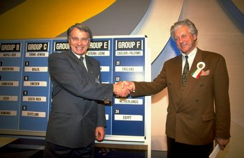 1990:  Bobby Robson of England and Thiys Librechts of Holland shake hands after looking at the draw during the 1990 World Cup Draw in Italy. \ Mandatory Credit: Simon  Bruty/Allsport