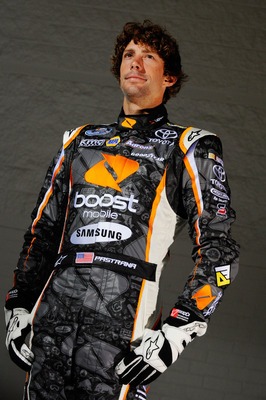 HUNTERSVILLE, NC - JULY 20:  Travis Pastrana, driver of the #99 Boost Mobile Toyota, poses during a media shoot prior to a press conference held at Michael Waltrip Racing on July 20, 2011 in Huntersville, North Carolina.  (Photo by Jason Smith/Getty Image