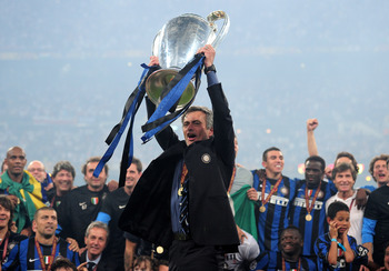 MADRID, SPAIN - MAY 22:  Jose Mourinho the Inter Milan coach holds the trophy aloft after winning the UEFA Champions League Final match between FC Bayern Muenchen and Inter Milan at the Estadio Santiago Bernabeu on May 22, 2010 in Madrid, Spain.  (Photo b