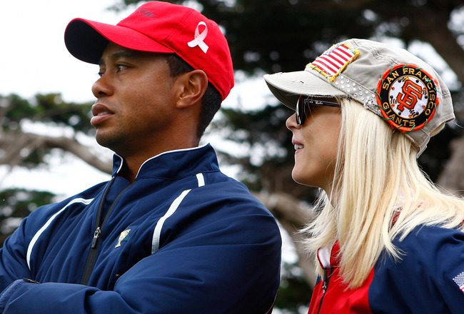SAN FRANCISCO - OCTOBER 11:  Tiger Woods of the USA Team waits with his wife Elin on the 13th green during the Final Round Singles Matches of The Presidents Cup at Harding Park Golf Course on October 11, 2009 in San Francisco, California.  (Photo by Scott