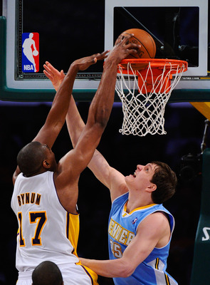 LOS ANGELES, CA - APRIL 03:  Timofey Mozgov #25 of the Denver Nuggets defends against Andrew Bynum #17 of the Los Angeles Lakers at Staples Center on April 3, 2011 in Los Angeles, California. NOTE TO USER: User expressly acknowledges and agrees that, by d