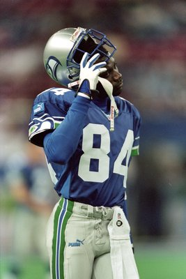 14 Nov 1999: Joey Galloway #84 of the Seattle Seahawks takes off his helmet as he walks off the field during a game against the Denver Broncos at The Kingdome in Seattle, Washington. The Seahawks defeated the Broncos 20-17. Mandatory Credit: Otto Greule J
