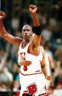 16 Jun 1993: Michael Jordan #23 of the Chicago Bulls celebrates during game four of the NBA Finals against the Phoenix Suns.