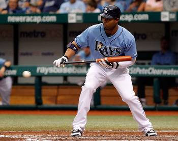 ST PETERSBURG, FL - JUNE 13:  Outfielder Carl Crawford #13 of the Tampa Bay Rays thinks about bunting against the Florida Marlins during the game at Tropicana Field on June 13, 2010 in St. Petersburg, Florida.  (Photo by J. Meric/Getty Images)