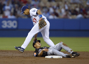 LOS ANGELES - APRIL 29:  Alex Cora #13 of the Los Angeles Dodgers walks over Danny Garcia #12 of the New York Mets after a double play in the 2nd inning April 29, 2004 at Dodger Stadium in Los Angeles, California.  (Photo by Harry How/Getty Images)