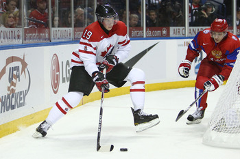 BUFFALO, NY - DECEMBER 26: Forward Ryan Johansen #19 of Canada looks to pass the puck from behind the net during the 2011 IIHF World U20 Championship game between Canada and Russia on December 26, 2010 at HSBC Arena in Buffalo, New York. (Photo by Tom Szc