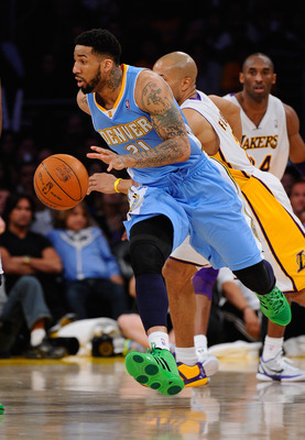 LOS ANGELES, CA - APRIL 03: Wilson Chandler #21 of the Denver Nuggets  drives past Derek Fisher #2 of the Los Angeles Lakers during the game at Staples Center on April 3, 2011 in Los Angeles, California. NOTE TO USER: User expressly acknowledges and agree