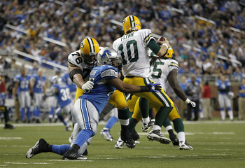 DETROIT - DECEMBER 12:  Matt Flynn #10 of the Green Bay Packers is sacked by Turk McBride #75 of the Detroit Lions  during the fourth quarter of the game against the Detroit Lions at Ford Field on December 12, 2010 in Detroit, Michigan. The Lions defeated