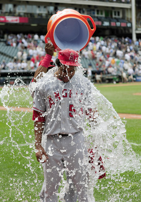 CLEVELAND, OH - JULY 27: Starting pitcher Ervin Santana #54 of the Los Angeles Angels of Anaheim is showered by teammate Erick Aybar #2 after Santana threw a no-hitter against the Cleveland Indians at Progressive Field on July 27, 2011 in Cleveland, Ohio.