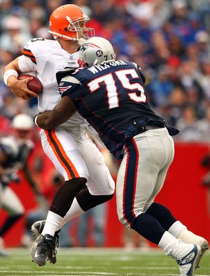 FOXBORO, MA - OCTOBER 07:  Derek Anderson #3 of the Cleveland Browns is sacked by Vince Wilfork #75 of the New England Patriots on October 7, 2007 at Gillette Stadium in Foxboro, Massachusetts. The Patriots defeated the Browns 34-17.  (Photo by Elsa/Getty
