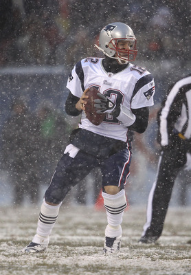CHICAGO, IL - DECEMBER 12: Tom Brady #12 of the New England Patriots looks for a receiver against the Chicago Bears at Soldier Field on December 12, 2010 in Chicago, Illinois. The Patriots defeated the Bears 36-7. (Photo by Jonathan Daniel/Getty Images)