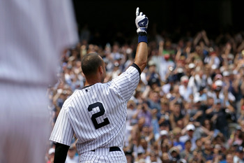 NEW YORK, NY - JULY 09:  Derek Jeter #2 of the New York Yankees waves to the fans after hitting a solo home run in the third inning for career hit 3000 while playing against the Tampa Bay Rays at Yankee Stadium on July 9, 2011 in the Bronx borough of New