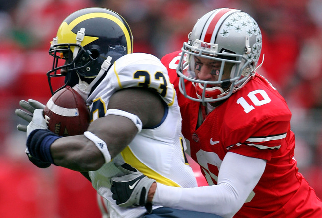 COLUMBUS, OH - NOVEMBER 22:  Devon Torrence #10 of the Ohio State Buckeyes tackles Boubacar Cissoko #33 of the Michigan Wolverines during the Big Ten Conference game at Ohio Stadium on November 22, 2008 in Columbus, Ohio.  (Photo by Andy Lyons/Getty Image