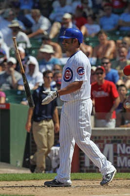 CHICAGO, IL - JULY 20:  Carlos Pena #22 of the Chicago Cubs flips his bat after striking out against the Philadelphia Phillies at Wrigley Field on July 20, 2011 in Chicago, Illinois.  (Photo by Jonathan Daniel/Getty Images)