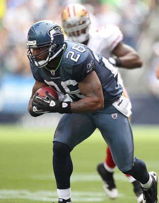 SEATTLE - SEPTEMBER 12:  Running back Michael Robinson #26 of the Seattle Seahawks rushes during the NFL season opener against the San Francisco 49ers at Qwest Field on September 12, 2010 in Seattle, Washington. The Seahawks defeated the 49ers 31-6. (Phot