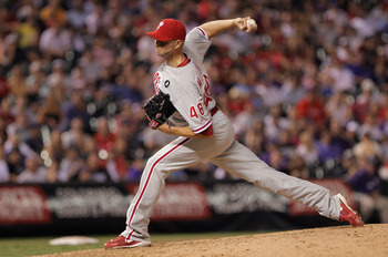 DENVER, CO - AUGUST 01:  Closer Ryan Madson #46 of the Philadelphia Phillies delivers against the Colorado Rockies in the 10th inning at Coors Field on August 1, 2011 in Denver, Colorado. Madson earned his 19th save as the Phillies defeated the Rockies 4-