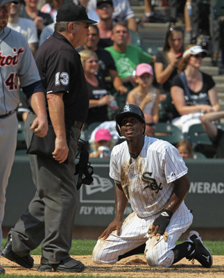 CHICAGO, IL - JULY 27: Juan Pierre #1 of the Chicago White Sox looks up at home plate umpire Derryl Cousins #13 after being tagged out at home plate against the Detroit Tigers at U.S. Cellular Field on July 27, 2011 in Chicago, Illinois. The White Sox def