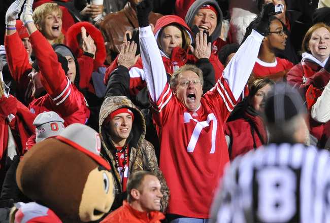 IOWA CITY, IA - NOVEMBER 20: Ohio State fans cheer on their teams as they take on the University of Iowa Hawkeyes at Kinnick Stadium on November 20, 2010 in Iowa City, Iowa. Ohio State won 20-17 over Iowa. (Photo by David Purdy/Getty Images).
