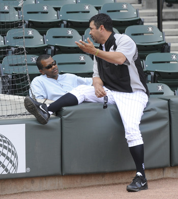 CHICAGO, IL - JUNE 07: Ozzie Guillen # 13 manager  of the Chicago White Sox (R) talks with White Sox General Manager Ken Williams before the game against the Seattle Mariners on June 7, 2011 at U.S. Cellular Field in Chicago, Illinois.  (Photo by David Ba