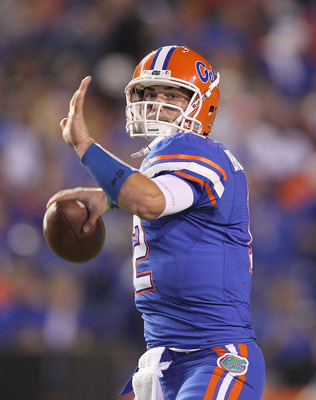 GAINESVILLE, FL - NOVEMBER 13: John Brantley #12 of the Florida Gators warms up during a game against the South Carolina Gamecocks at Ben Hill Griffin Stadium on November 13, 2010 in Gainesville, Florida.  (Photo by Mike Ehrmann/Getty Images)