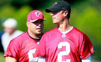 FLOWERY BRANCH, GA - JULY 30:  Quarterback Matt Ryan #2 of the Atlanta Falcons waits for warmup drills during Falcons Training Camp at the Falcons Training Complex on July 30, 2011 in Flowery Branch, Georgia.  (Photo by Kevin C. Cox/Getty Images)