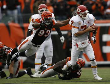 CINCINNATI - DECEMBER 27: Matt Cassel #7 of the Kansas City Chiefs is sacked by Michael Johnson #93 and Robert Geathers #91 of the Cincinnati Bengals in their NFL game at Paul Brown Stadium December 27, 2009 in Cincinnati, Ohio.    (Photo by John Sommers