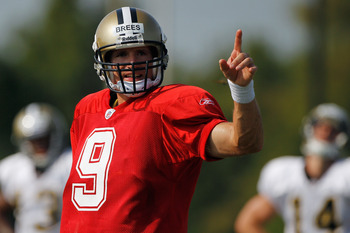 METAIRIE, LA - AUGUST 03:  Quarterback Drew Brees #9  of the New Orleans Saints works out during practice at the New Orleans Saints training facility on August 3, 2011 in Metairie, Louisiana.  (Photo by Chris Graythen/Getty Images)