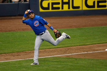 MILWAUKEE, WI - JULY 28: Aramis Ramirez #16 of the Chicago Cubs throws the baseball after fielding a ground ball against the Milwaukee Brewers at Miller Park on July 28, 2011 in Milwaukee, Wisconsin. (Photo by Scott Boehm/Getty Images)