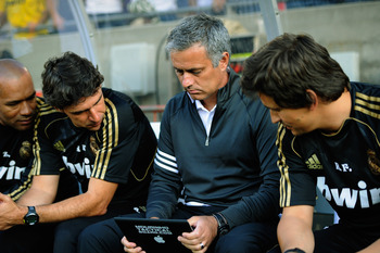 LOS ANGELES, CA - JULY 16:  Jose Mourinho coach of Real Madrid follows the action with his coaching staff during the Herbalife World Challenge 2011 friendly soccer game against Los Angeles Galaxy at Los Angeles Memorial Coliseum on July 16, 2011 in Los An