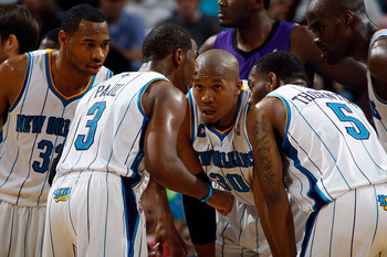 NEW ORLEANS, LA - DECEMBER 15:  Chris Paul #3  of the New Orleans Hornets talks with his team during a time out in the game against the Sacramento Kings at the New Orleans Arena on December 15, 2010 in New Orleans, Louisiana.  NOTE TO USER: User expressly