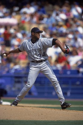 28 May 2001:   Pedro Astacio #34 of the Colorado Rockies winds up to pitch during the game against the Los Angeles Dodgers at Dodger Stadium in Los Angeles, California. The Dodgers defeated the Rockies 11-10.Mandatory Credit: Jeff Gross  /Allsport