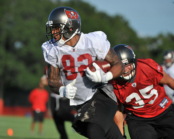 TAMPA, FL - JULY 29:  Tight end Kellen Winslow #82 of the Tampa Bay Buccaneers runs upfield with a pass during the team's first pre-season training camp practice July 29, 2011 at One Buccaneer Place in Tampa, Florida. (Photo by Al Messerschmidt/Getty Imag
