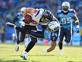 NASHVILLE, TN - DECEMBER 19:  Chris Hope #24 of the Tennessee Titans tackles Owen Daniels #81 of the Houston Texans at LP Field on December 19, 2010 in Nashville, Tennessee. The Titans defeated the Texans, 31-17.  (Photo by Grant Halverson/Getty Images)