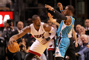 MIAMI, FL - DECEMBER 13:  Dwyane Wade #3 of the Miami Heat is guarded by Chris Paul #3 of the New Orleans Hornets during a game at American Airlines Arena on December 13, 2010 in Miami, Florida. NOTE TO USER: User expressly acknowledges and agrees that, b